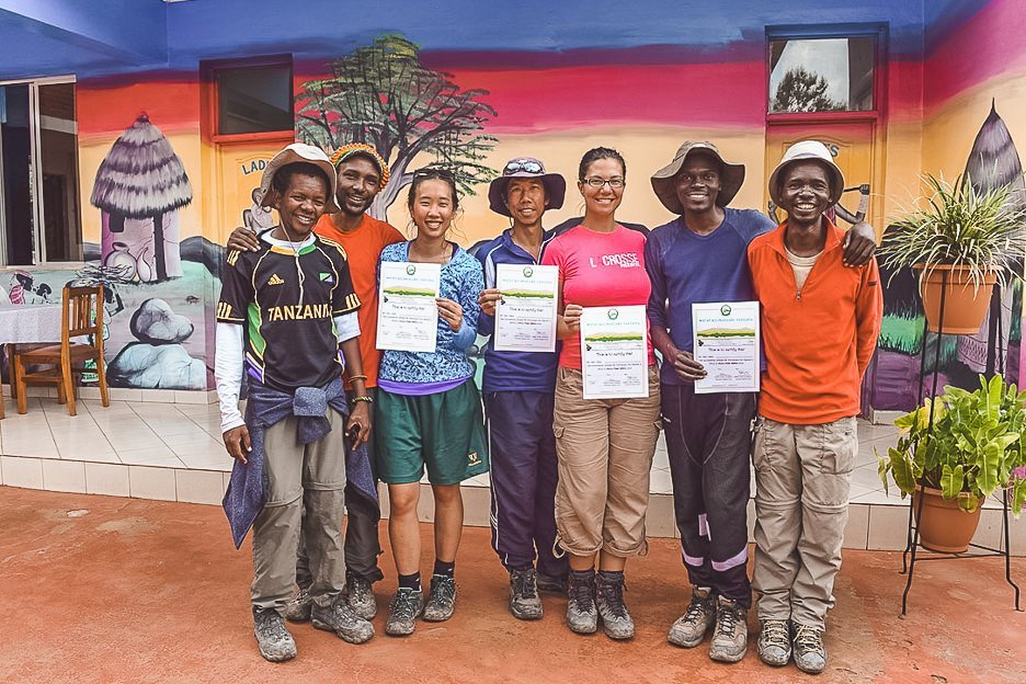 The group receiving their certificates after successfully summitting Mt Kilimanjaro