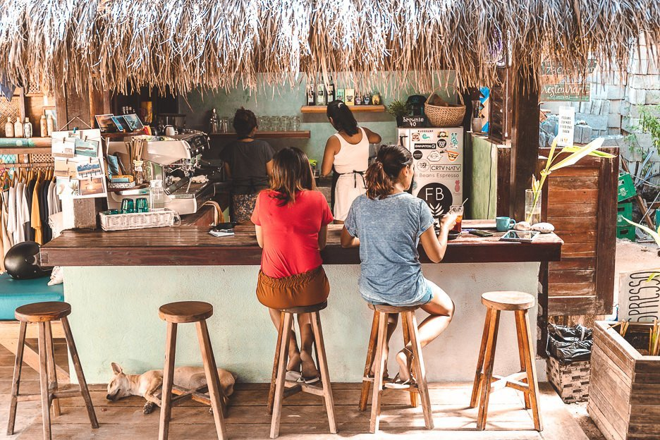 Customers sit at the coffee kiosk at Fili Beans Espresso - Cafe in Siargao