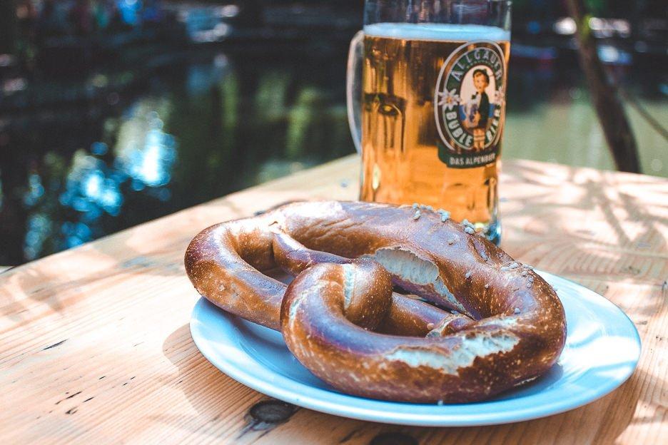 Pretzel and beer in the beergarden of Cafe Am Nueun See, Berlin