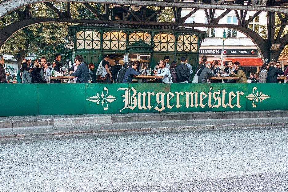 People eating burgers at Burgermeister, Berlin