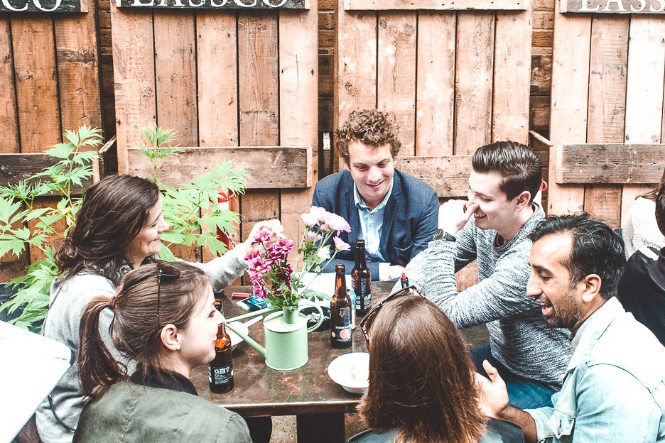 Group of friends enjoying a drink at Maltby Street Market
