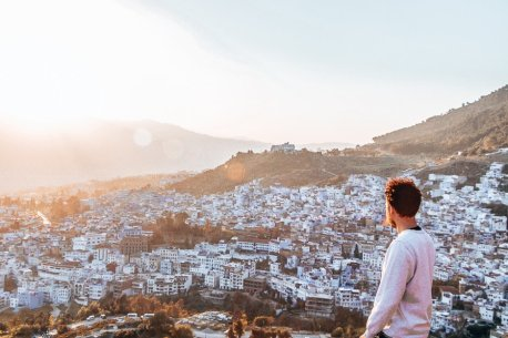 Bevan of The Travel Quandary looks towards sunset over the city, Chefchaouen Morocco