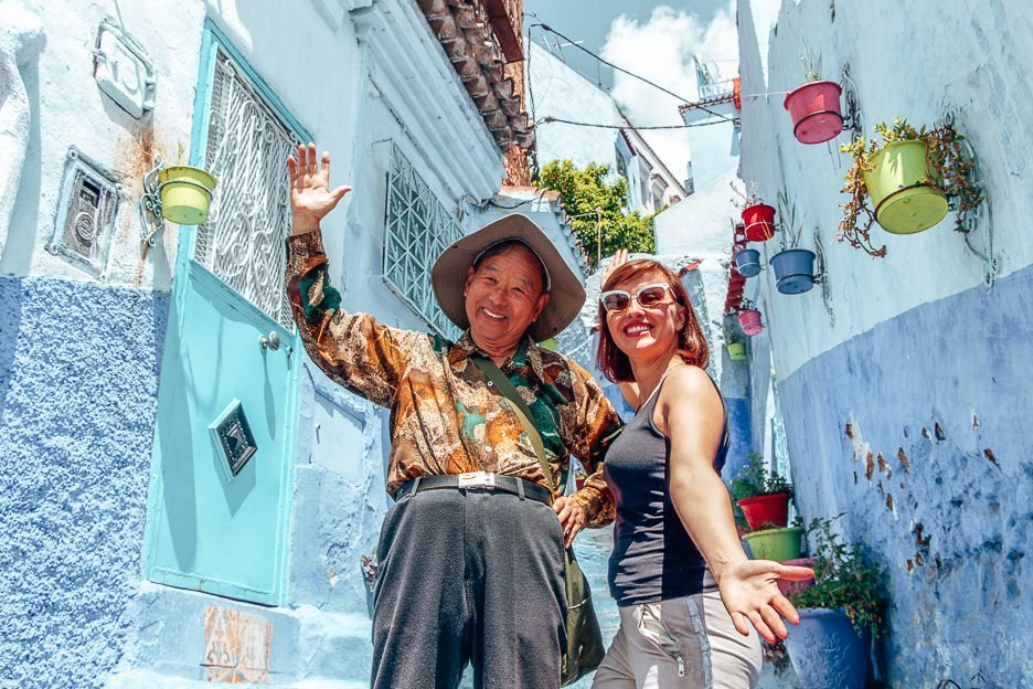 Two tourists pose for a photo in Chefchaouen Morocco