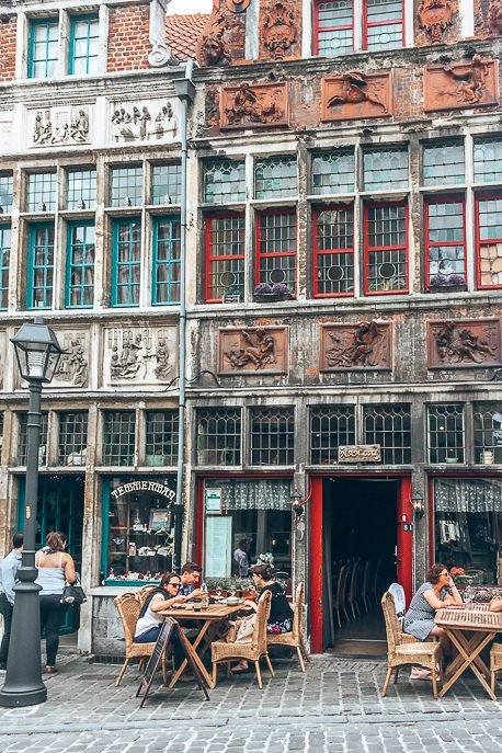 Diners sit outside a restaurant in Ghent, Belgium