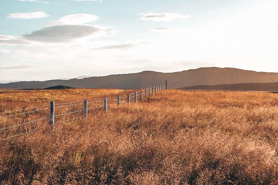 The sun setting over grassy plains, Iceland