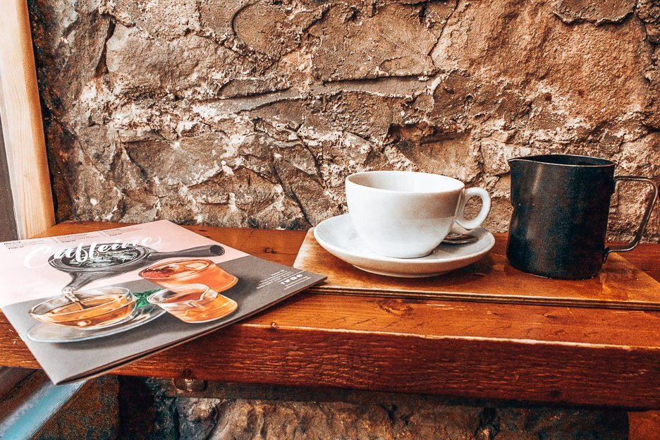 Filter coffee and magazine on a bench table at Brew Lab, Edinburgh