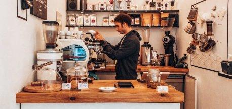 Barista works behind the counter at Kaffeemodul, Vienna