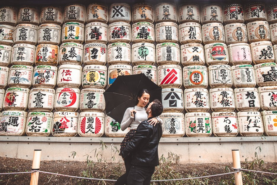 A couple in front of the sake barrels at Meiji Shrine, Tokyo