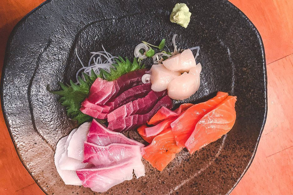 A plate of seafood sashimi - must try Japanese Food