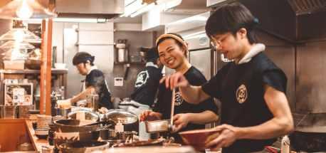 Chefs in the kitchen making ramen in Tokyo, Japan