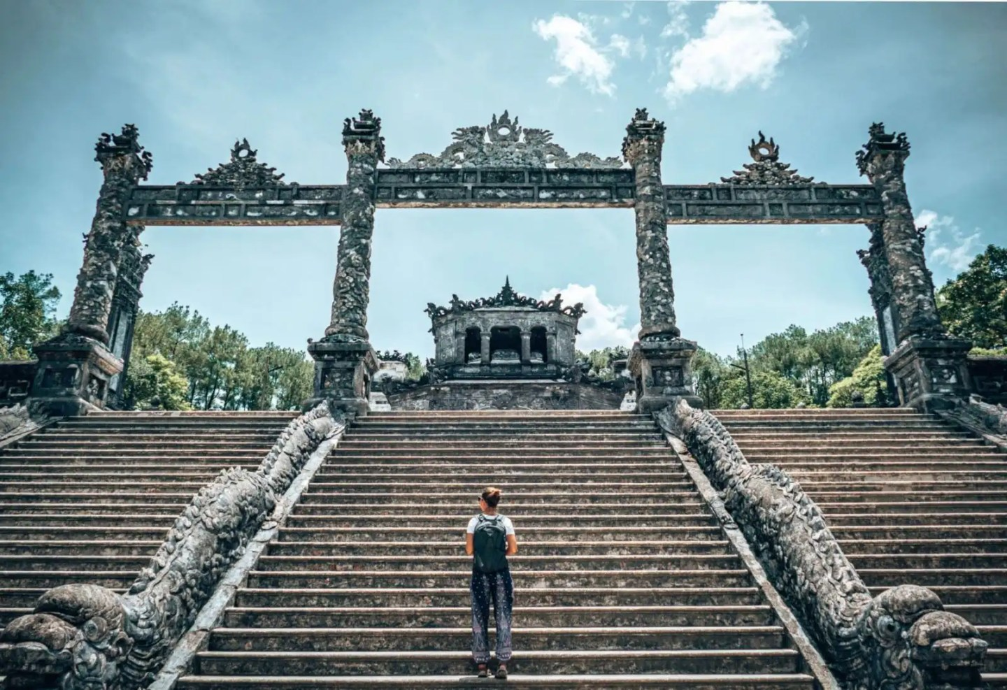 Girl walking up stairs at the Khai Dinh tomb in Hue Vietnam