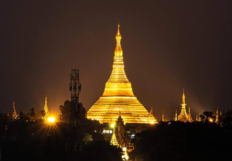 Picture of the Schwedagon Pagoda at night, in Yangon, Myanmar