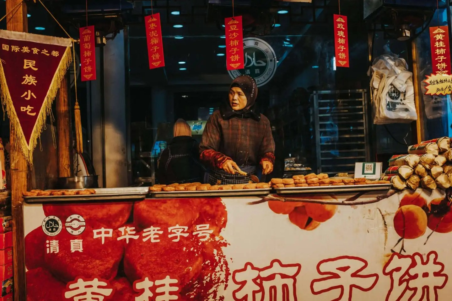 Image of woman selling food in the Muslim Quarter in Xian China