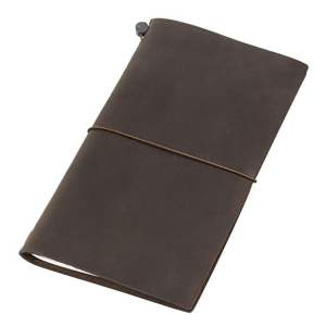 one of the best travel gifts for him is a midori traveler's notebook