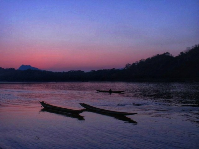 sunset at the mekong river one of the Luang Prabang top things to do
