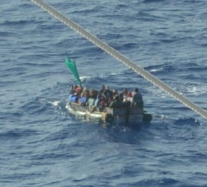 Refugees floating in a small raft in the Florida Straights.