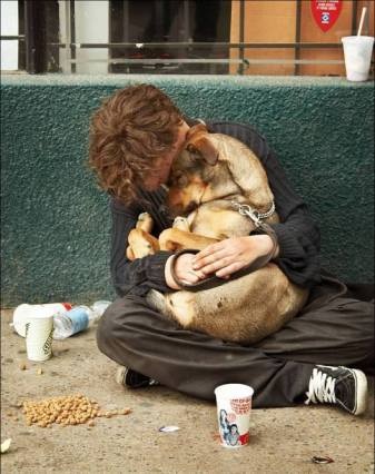 Homeless Man On Street With Pet