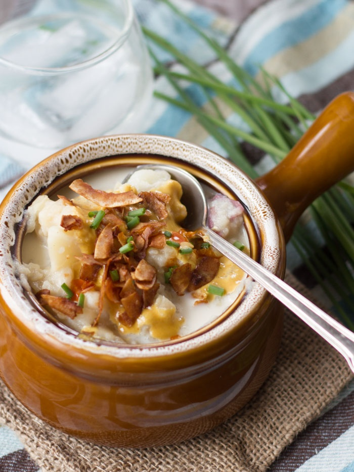 image of vegan loaded potato soup with coconut bacon topping, links to recipe