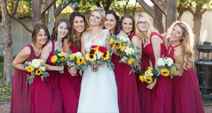 Picture of bridesmaids in crimson vegan bridesmaid dresses with bride