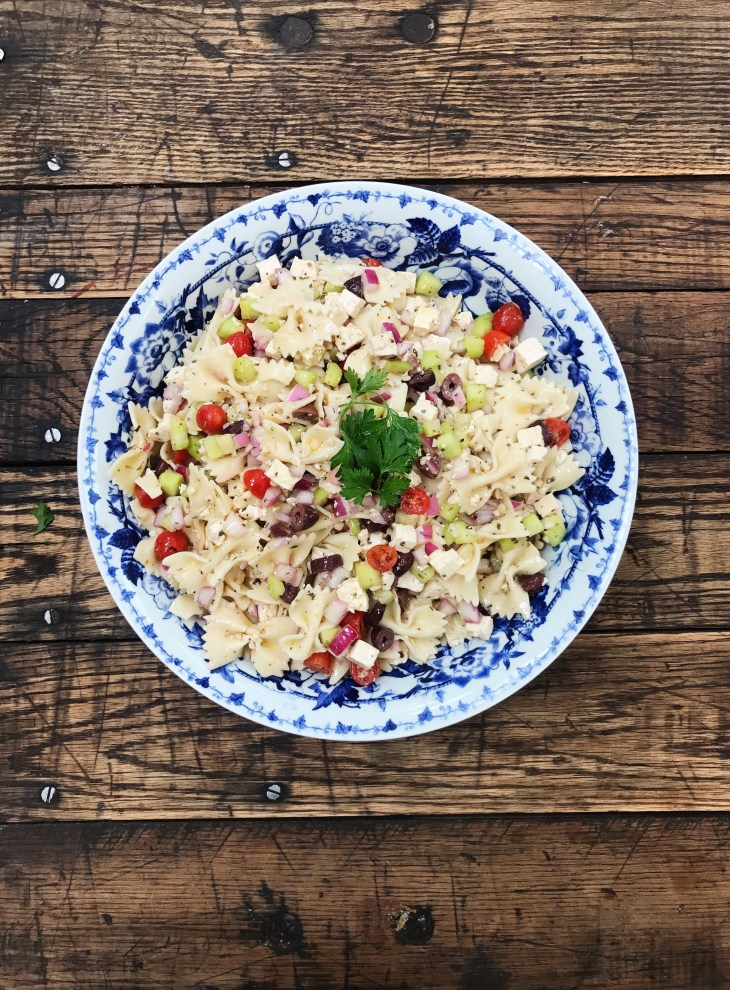 bowl of vegan Mediterranean pasta salad with tofu feta