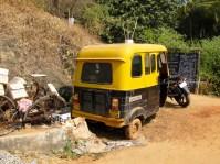 Broken yellow rickshaw