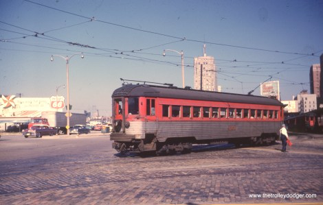 "Silverliner 762 gets flagged through the busy ""throat"" of the Milwaukee terminal, circa 1960."