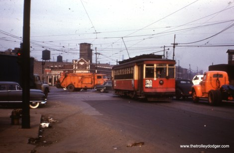 """CTA 661 on Blue Island. Andre Kristopans says, """"661 – WB just west of Blue island/Cermak/Ashland intersection. Note that """"Jerry's Grill"""" in the background was once a bank according to Stone above corner door!"""""""