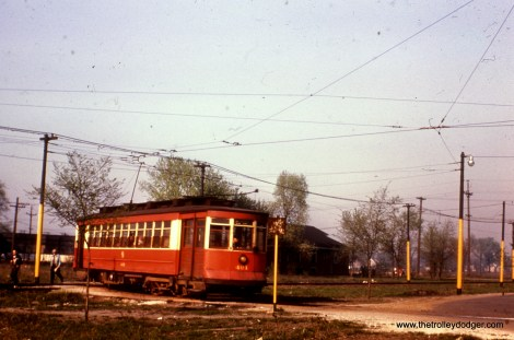 """According to Andre Kristopans, """"CTA 491 is coming into 63 Pl/Narragansett loop. The driveway to the right of the car is how the 65A-63rd/65th extension buses exited. Later this whole area was paved over for bus use, and recently over half of the property became the site of a branch library, leaving only a very small bus loop."""""""