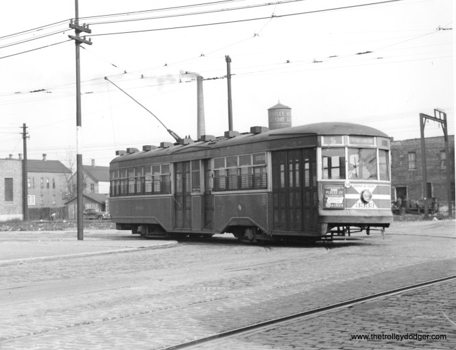 """Bob Lalich says, """"CTA """"sedan"""" 3333 is turning west on 93rd St from Baltimore Ave. The IC South Chicago Branch can be seen in the background."""""""