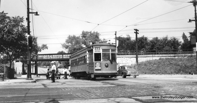 CSL 3057 on route 17, the Kedzie through route, at Belmont. The Kennedy Expressway now runs past this spot on elevation. The through route was replaced by buses on December 4, 1949.