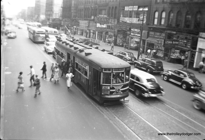 CTA 6282 unloads passengers in the early 1950s. Note the postwar Pullman PCC at rear.