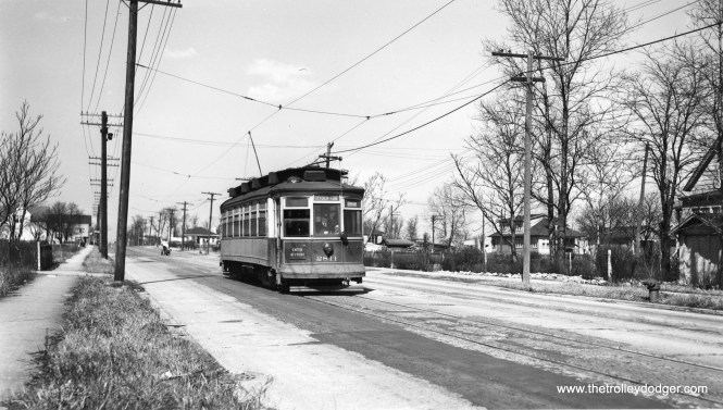 """Roy Benedict says, """"The southbound car (CSL 2811) is passing in front of 12423 S. Michigan Avenue."""" Andre Krisotpans adds,""""The filling station visible behind the car with the overhang burned down in 2013."""" (Joe L. Diaz Photo)"""
