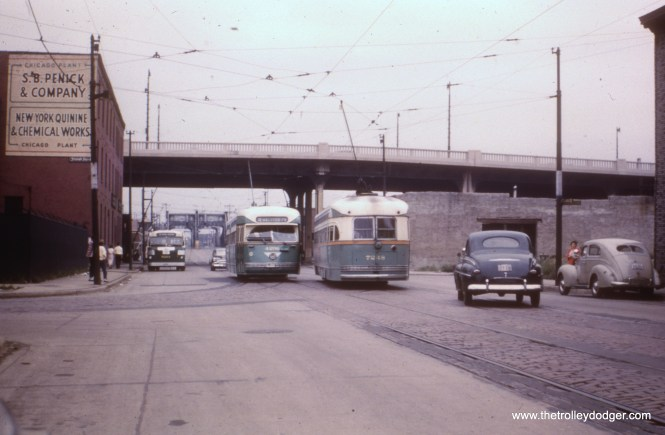 """According to Andre Kristopans, """"#3 is looking west on Division at Crosby. Cars are on detour via Halsted-Division-Crosby-Larrabee-Chicago-Halsted."""" The Ogden overpass, since demolished, is at rear."""