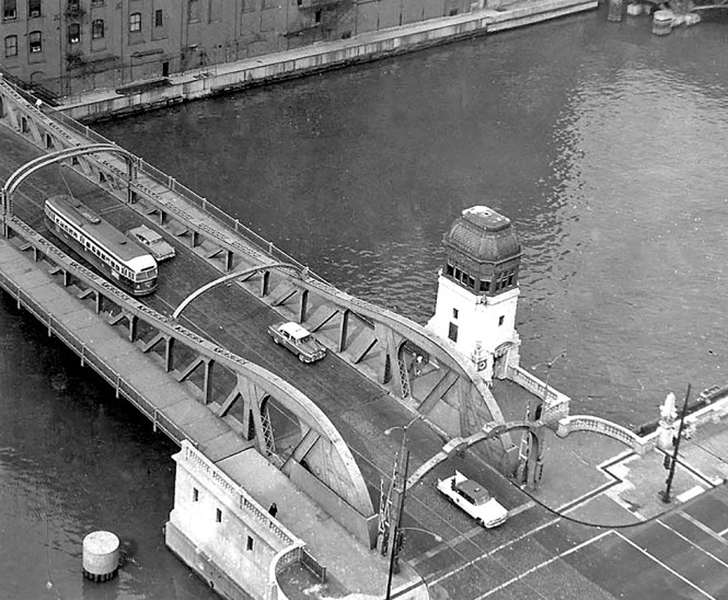 Taken from the 19th floor (I think) showing a southbound PCC car on the Clark Street Bridge. One of my favorites. At that time WFMT had their studios on the same floor. Probably taken in early 1958. © Laurence Mack