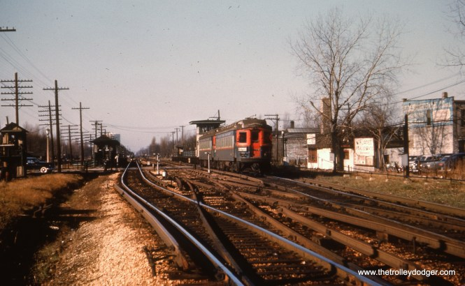 #22 - EM: Gunderson Av. station with westbound CAE train approaching the station looking NW. CAE 428 (Cincinnati, 1927) is at the rear of the two-car train. AK: Gunderson Av passing track, this is towards the end as the middle track is rusted black.