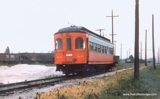 #34 - EM: CAE 310 (Hicks, 1907) southbound at the stone quary on the west side of Mannheim Road, probably the same fan trip as in picture #30. View is looking NW. AK: On Cook County Branch around Jackson or so, next to Mannheim Rd.