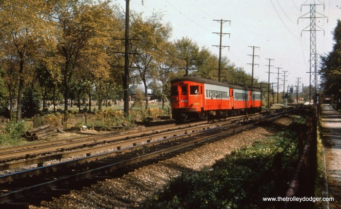 #48 - EM: CAE 451 (St. Louis, 1945) leads a three-car westbound consist just west of the Des Plaines Av. interchange with the CTA. It is about to pass through the two cemeteries before crossing the Des Plaines river and turning NW towards 1st Av. Maywood. (Editor's note: off to the left, but not visible in this picture, would have been a large gas tank that was a Forest Park landmark for many years. This is the location of the Eisenhower expressway today.)