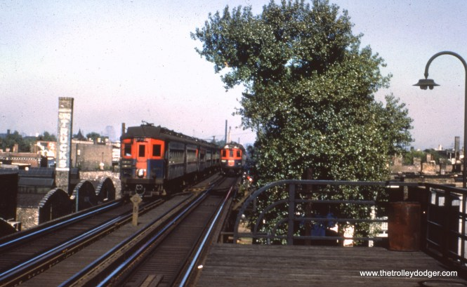 """#55 - JN: CA&E trains passing at Western Ave. on Garfield """"L"""" EM: CAE 408 (Pullman, 1923) approaches Western Av station. Looking East."""