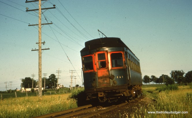 #66 - JN: Westbound car is just departing Batavia Jct. EM: CAE 141, an ex-North Shore Line car most likely in Kane county on the Batavia branch.