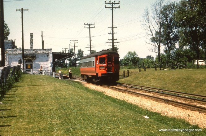 #73 - JN: Eastbound train at Warrenville. Station later served as Warrenville city hall. EM: CAE 458 (St. Louis, 1945) at Warrenville.