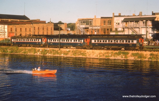 #74 - JN: Aurora terminal EM: CAE 414 (Pullman, 1923) and two Cincinnati cars along the Fox River at the Aurora station. Observe the raised trolley poles.