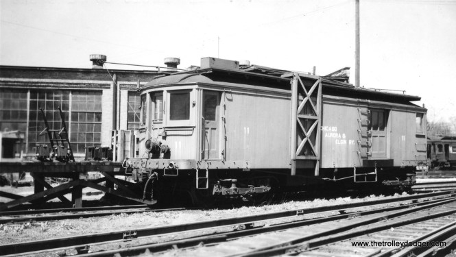"#9 -CA&E line car 11. According to Don's Rail Photos, ""11 was built by Brill in 1910, (order) #16483. It was rebuilt to a line car in 1947 and replaced 45. It was acquired by Railway Equipment Leasing & Invenstment Co in 1962 and came to Fox River Trolley Museum in 1984. It was lettered as Fox River & Eastern."