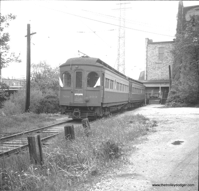 #14 - CA&E wood cars 310 and 309 at Batavia station on a May 19, 1957 fantrip. According to Don's Rail Photos, 309 and 310 were built by Hicks Car Works in 1907 and modernized in October 1941. Car 309 was acquired by the Illinois Railway Museum in 1962.