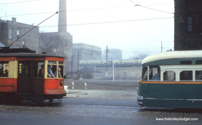 """CTA streetcars 225 and 4406, in fantrip service, at Broadway and Ardmore on October 21, 1956., with 6000s on the """"L"""" in the background."""