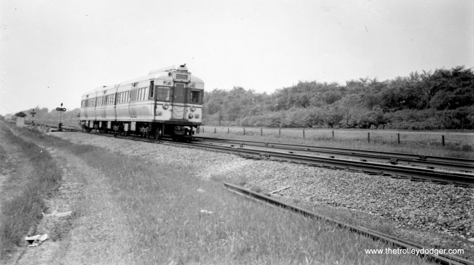 """CTA articulated set 5002 in April 1949, in Garfield-Westchester service. George Foelschow says, """"5002 is shown eastbound on CA&E owned track between Austin and Central with the wilds of Columbus Park in the background. The track map indicates a crossover and the interchange track with the B&OCT. Note the switch stands."""""""