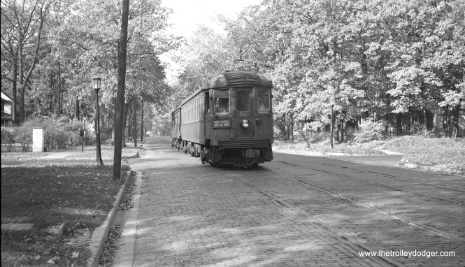 "A two-car (170-709) North Shore Line Chicago Express ""at speed"" (although most likely moving very slowly) at Fifth and Greenleaf Avenue in Wilmette on the Shore Line Route, October 24, 1948. (Richard H. Young Photo)"