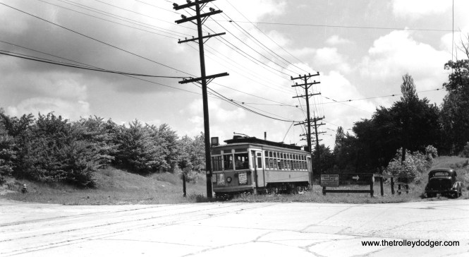 """Don's Rail Photos says, """"589 was built by St Louis Car Co in 1911. It was rebuilt in 1927."""" This car is shown at the end of one of the Milwaukee city streetcar lines in West Allis. Charles Kronoenwetter says, """"589 is coming off the short section of private right-of-way which ran between Mitchell St. and Becher St. onto Becher St."""""""