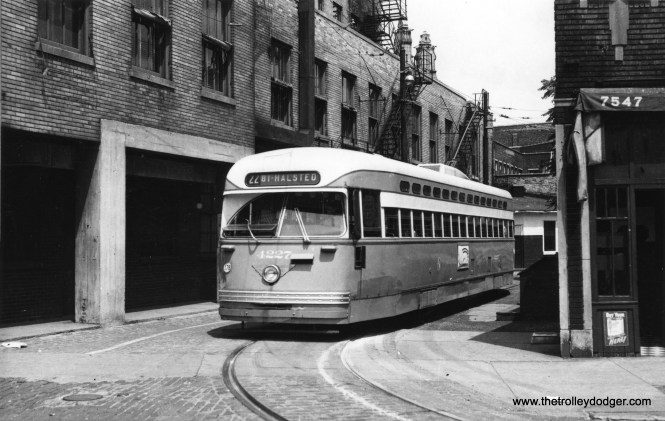 "PCC 4227, at Clark and Howard, prepares to head south on route 22 - Clark-Wentworth. The building on the left is still there. You would hardly recognize this location, which has been converted to an outdoor cafe. When this turnback loop was constructed, the surface and rapid transit systems competed against each other and there was little effort to coordinate them. After CTA was created, buses were diverted to bring passengers directly to the Howard ""L"" terminal, some distance behind the scene of this photo. Car 4227, a Pullman product, was delivered on March 7, 1948, and scrapped on August 15, 1953, a service live of less than 5 1/2 years. (Railway Negative Exchange Photo)"
