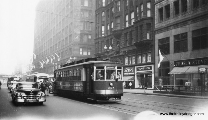 Red Pullman 225, with a postwar PCC follwing behind, on a circa 1956-57 fantrip on State Street. That looks like a 1953 Cadillac at left. The building at rear with the flags is Marshall Field's. (Railway Negative Exchange Photo)