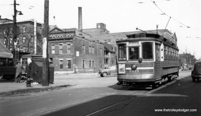 "1415 yet again, on the Webster-Racine route. This time the destination is clearly visible as Racine and Fullerton. Bill Shapotkin writes, ""Believe this photo is taken at Webster/Lincoln (view looks east) -- which was the east (south(?)) end-of-the-line. (Note that the cross-street is an angular street. The streetcar (left) would be heading S/B in Lincoln."" (Joe L. Diaz Photo)"
